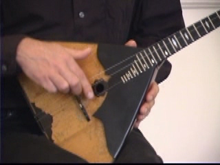 Balalaika Tutorial on DVD by Alex Siniavski. Lesson 2. THUMB PIZZICATO