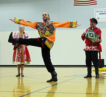 Dancer Serhiy Tsyganok, Elina Karokhina (balalaika), Mikhail Smirnov (garmoshka), Russian traditional song and dance, Kalinka, Sixth Grade Academy, Lovington, New Mexico, photo by Jaycie Chesser